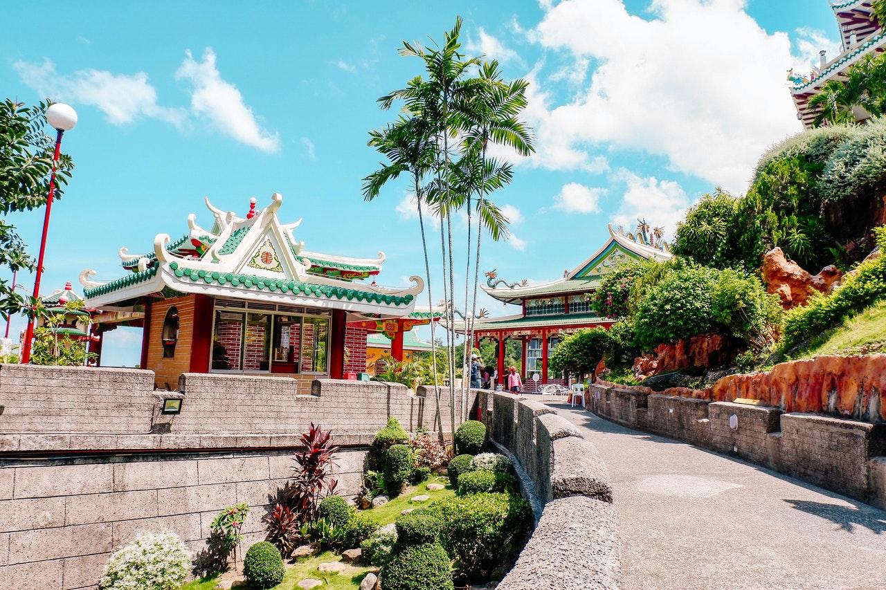 pagoda-near-tall-trees-under-blue-sky-1364557